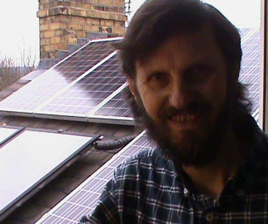 Graham Wroe with newly installed solar panels on his roof, 2010