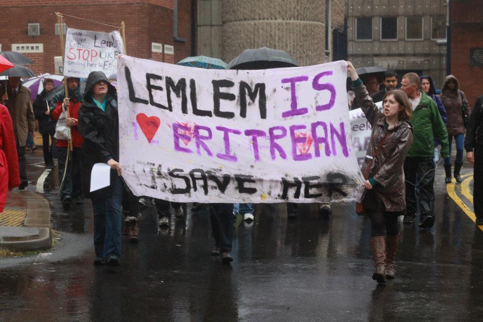 Lemlem is Eritrean- Demo banner in pouring rain