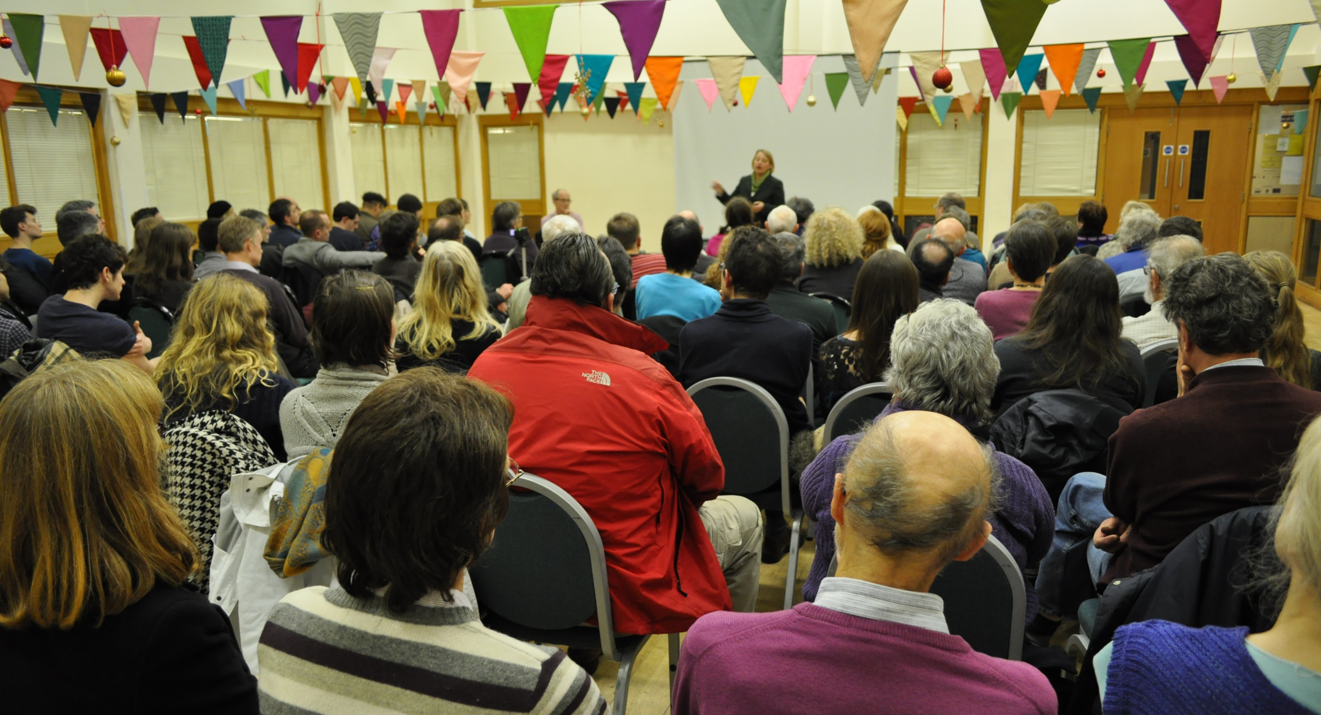 The audience at Sheffield Greens AGM 2013 with Natalie Bennett, Leader, speaking.