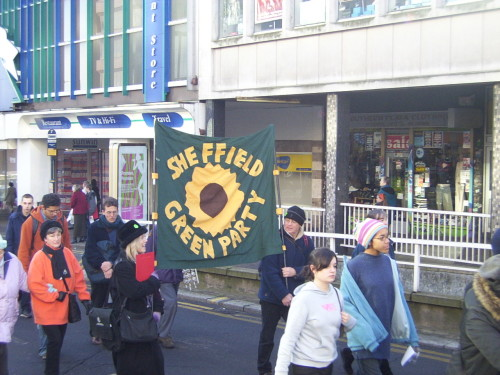 "Leela carrying the Green Party banner on the ""We want our buses back"" demo in 2005"