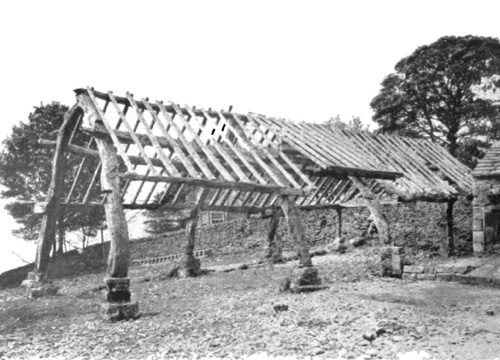 A frame of a cruck house before demolition