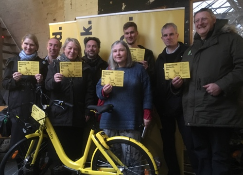 Martin Phipps (3rd from right) with Natalie Bennett and Green councillors and activists with Ofo bike